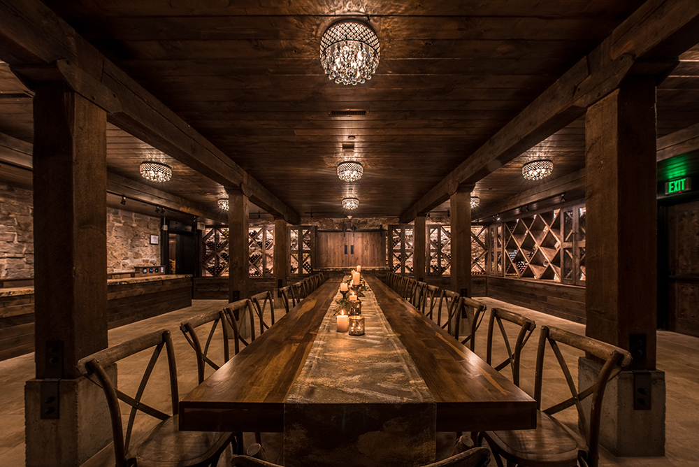 Photo of the Wine Cellar at Ginger & Baker showing a darker interior with heavy wooden accents.