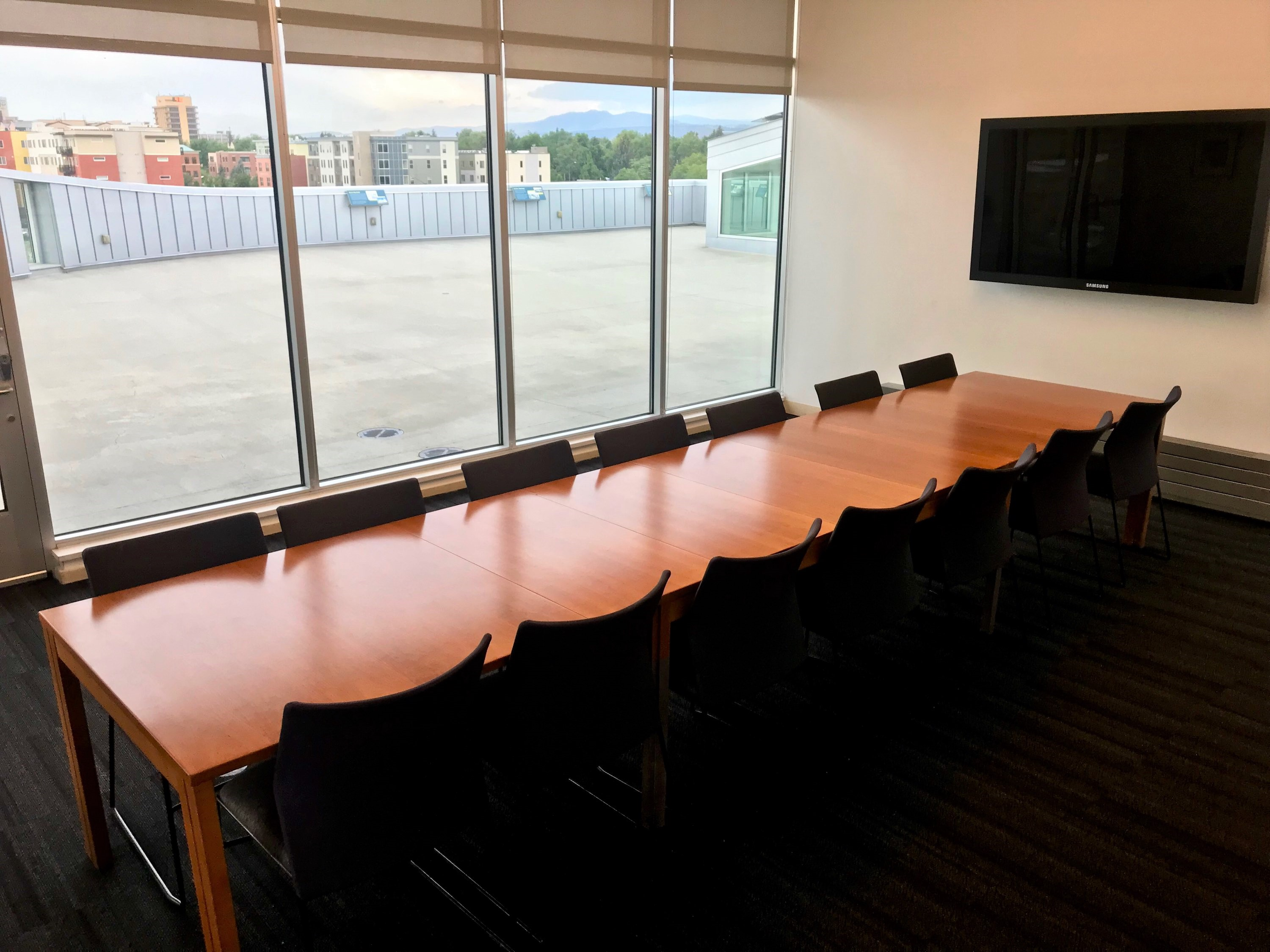 View of the Markley room showing a boardroom setup and view facing south over the rooftop.